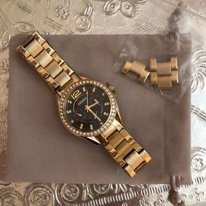 Fossil women's gold watch with black face